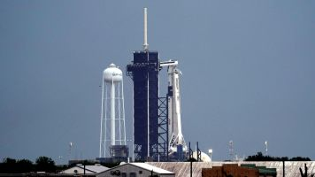 Historic SpaceX launch delayed by weather
