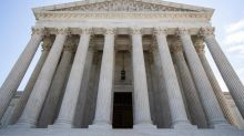 Justices keep hold on secret Russia investigation material
