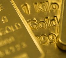 Gold Trims Monthly Loss With Dollar Slipping Ahead of U.S. Vote