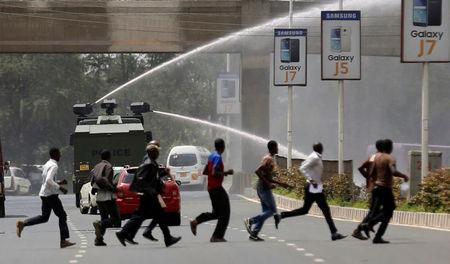 Riot police use a water-cannon to disperse supporters of Kenya's opposition Coalition for Reforms and Democracy (CORD) during a protest at the premises hosting the headquarters of Independent Electoral and Boundaries Commission (IEBC) to demand the disbandment of the electoral body ahead of next year's election in Nairobi, Kenya, May 23, 2016. REUTERS/Thomas Mukoya