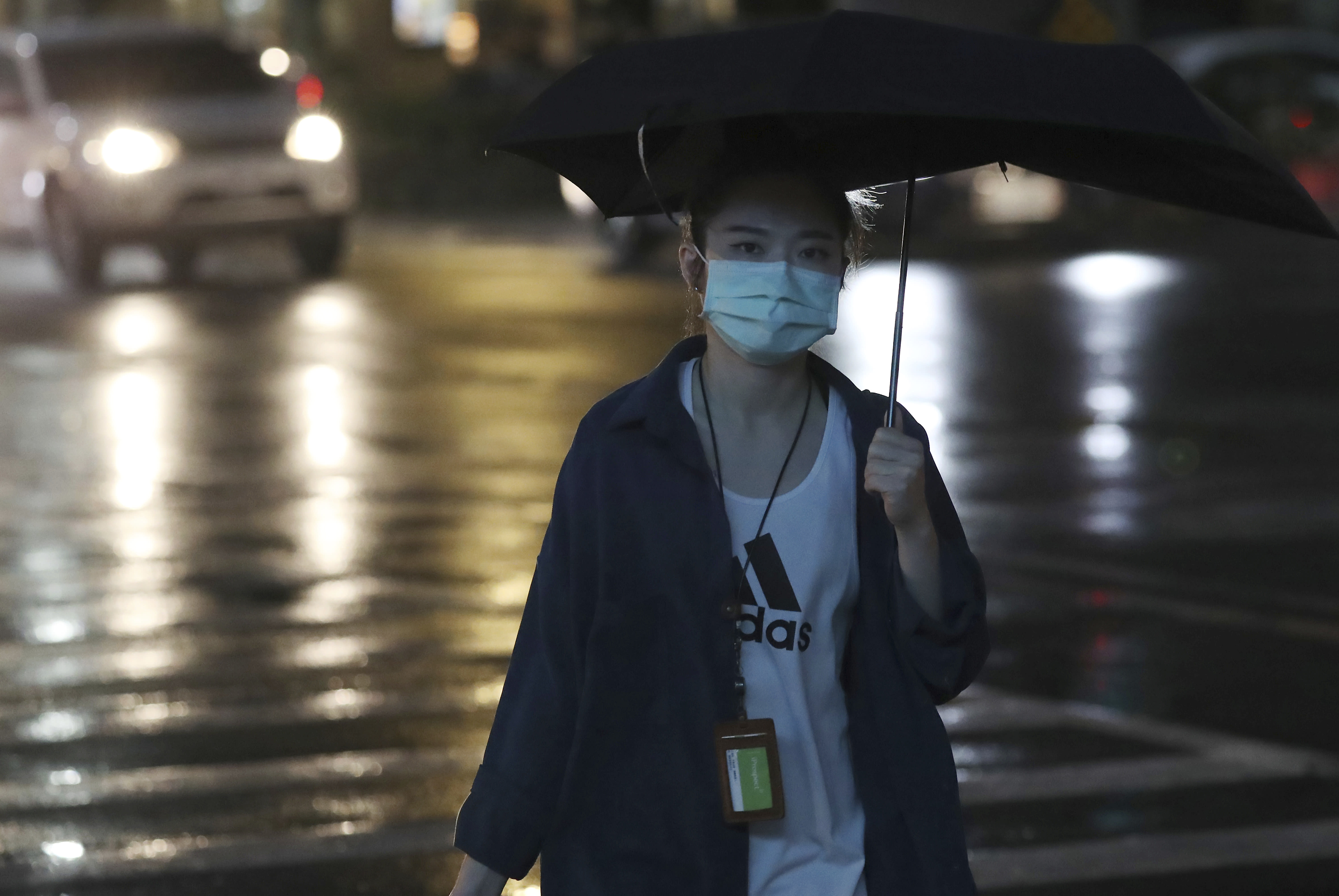 People wear face masks to protect against the spread of coronavirus in Taipei, Taiwan, Saturday, Oct. 17, 2020. (AP Photo/Chiang Ying-ying)