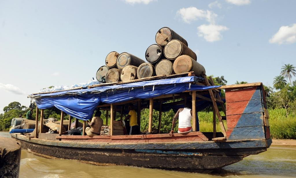 Products of illegal oil refineries in jerry cans are ferried to the market in Bayelsa State on the Niger Delta on April 11, 2013 (AFP Photo/Pius Utomi Ekpei)