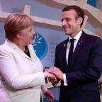 Macron, Merkel defend multilaterism as Trump avoids peace forum
