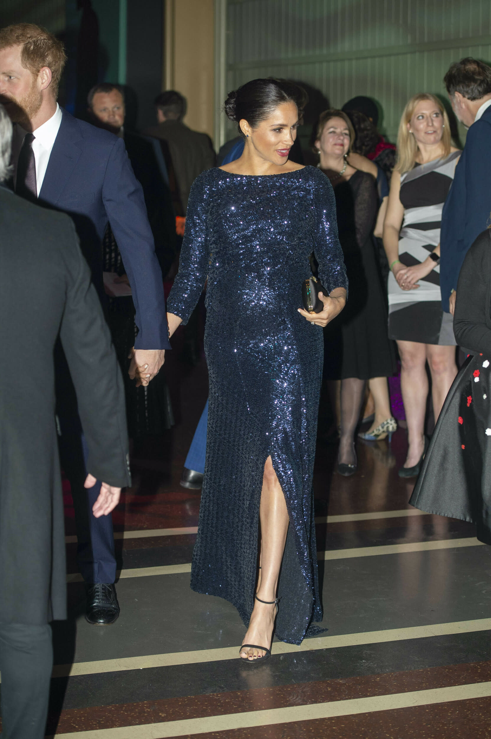 """The Duchess of Sussex attended the premiere of Cirque du Soleil's Totem in support of Prince Harry's charity Sentebale, which helps fight against AIDS in southern Africa. She donned a <a href=""""https://fave.co/2TeDAeZ"""">long-sleeved Roland Mouret gown</a> and <a href=""""https://fave.co/2WmsBBQ"""">Stuart Weitzman heels</a> for the occasion."""