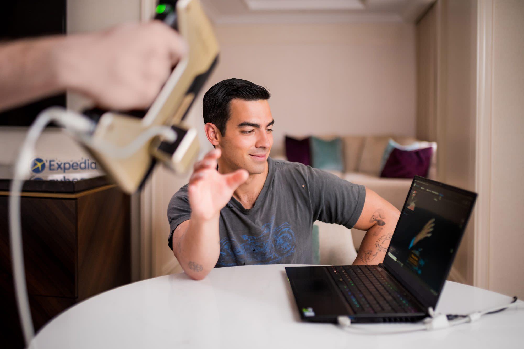 Why Expedia is giving away Joe Jonas's hand replicas