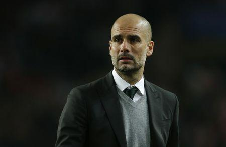 Manchester City manager Pep Guardiola looks dejected after the game