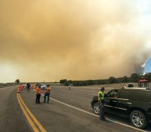 400 more homes evacuated by growing fire near Utah ski town