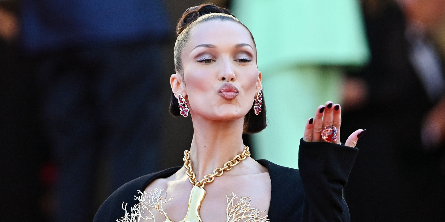 Bella Hadid just wore a daring gold lung dress to Cannes