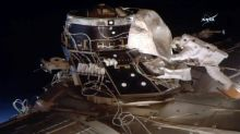 Space blanket floats away during historic spacewalk