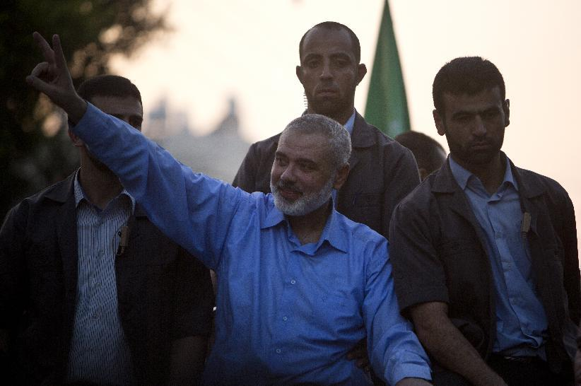 Hamas leader Ismail Haniya (centre) waves to the crowd during a rally in Gaza City, on August 27, 2014
