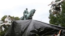 Man tries to cut shroud from Robert E. Lee statue in Charlottesville