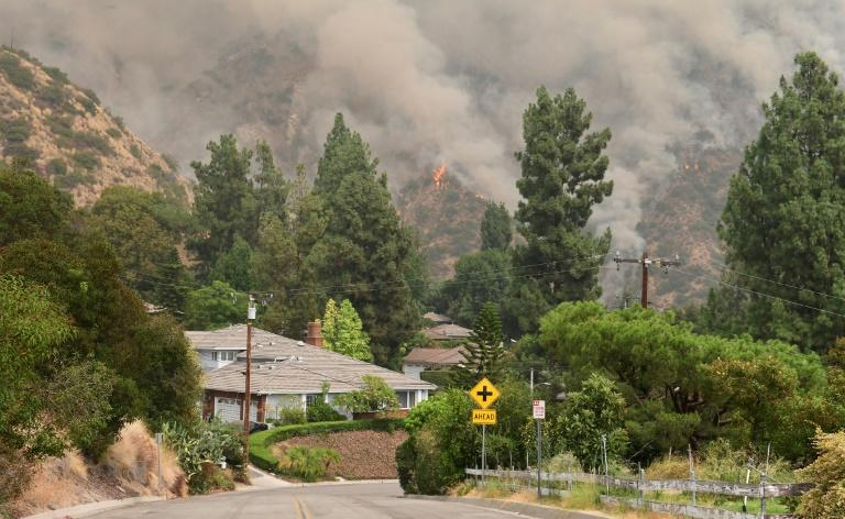 The Bobcat Fire burns on a hillsides behind homes in Arcadia, California on September 13, 2020