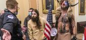 Trump supporters, including Jacob Chansley, right, are confronted by U.S. Capitol Police officers inside the Capitol on Jan. 6. (AP)