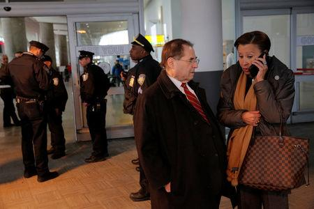 Congressman Jerrold Nadler (L) and Congresswoman Nydia Velazquez (R) stand in the entrance of Terminal 4 at John F. Kennedy International Airport in Queens, New York, U.S., January 28, 2017. REUTERS/Andrew Kelly