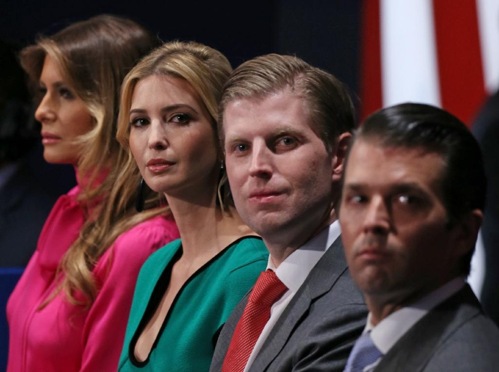Donald Trump's wife Melania (far left) sits with his daughter Ivanka and sons Eric and Don Jr. during the second presidential debate (AFP Photo/Tasos Katopodis)