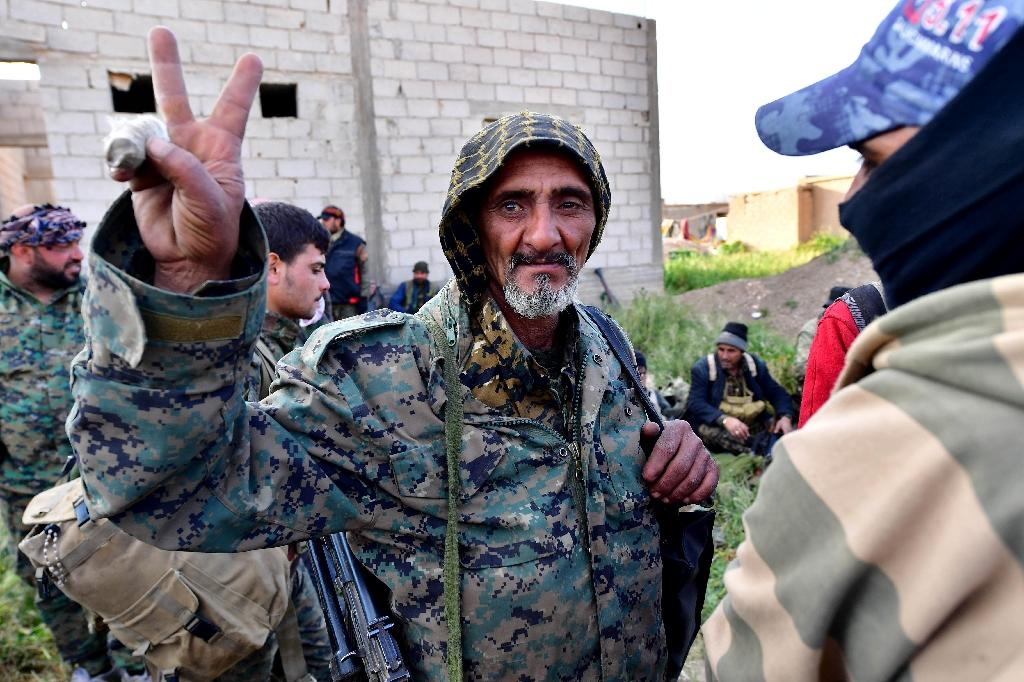 For the jubilant fighters of the Syrian Democratic Forces, the imminent fall of the Islamic State group's last redoubt marks the culmination of a bruising six-month operation in which they have taken heavy casualties (AFP Photo/GIUSEPPE CACACE)