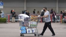 Large queues and full trolleys suggest panic buying ahead of new lockdown