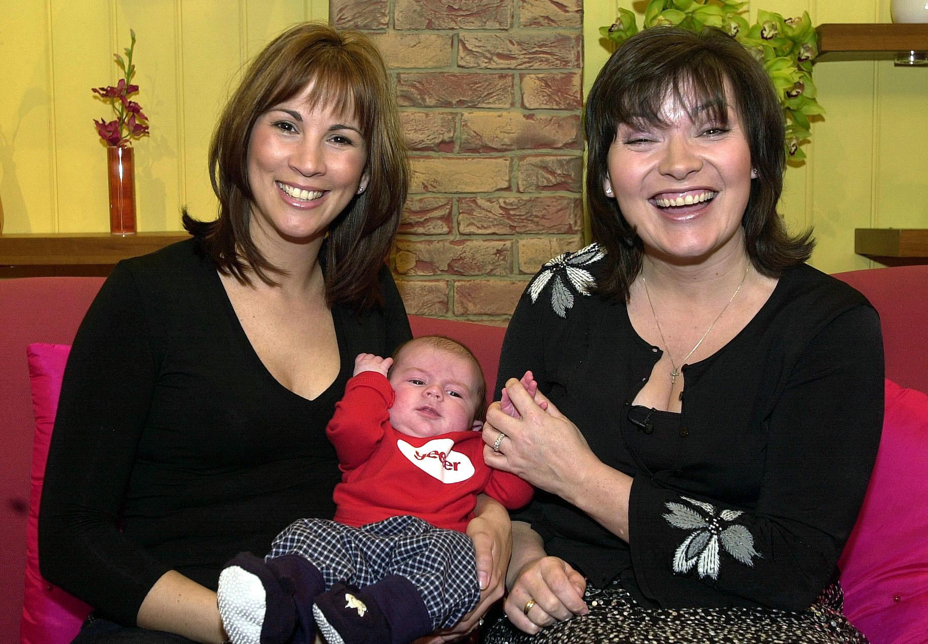 GMTV weather presenter Andrea McLean (left) with her 11-week-old son Finlay and GMTV presenter Lorraine Kelly after appearing on the show in London.