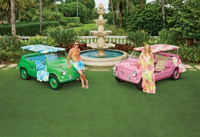 Tanned models lean against his and hers island cars