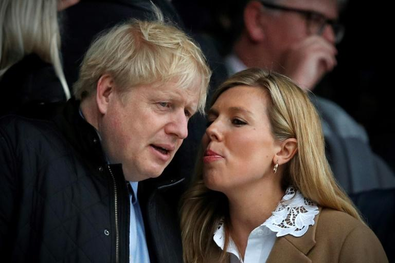 Johnson and his partner Carrie Symonds (AFP Photo/ADRIAN DENNIS)