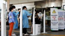 Surge in South Korea coronavirus cases sparks hospital bed shortage concerns