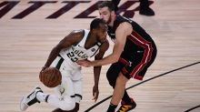 Bucks hold on without Giannis Antetokounmpo, extend series after Game 4 overtime win against Heat
