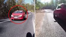 Queensland cyclist records 'bone chilling encounter' with car