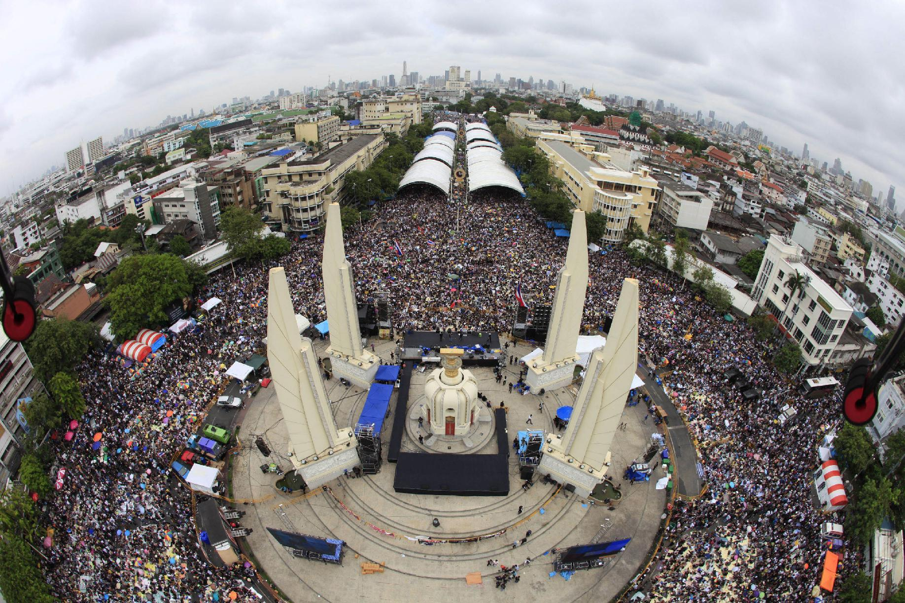 In this photo released by Siam 360 and taken from a drone, anti-government protesters stage a rally, calling for Thai Prime Minister Yingluck Shinawatra to step down, at Democracy Monument in Bangkok, Thailand, Sunday, Nov. 24, 2013. In the United States, the Federal Aviation Administration is developing new rules as the technology makes drones far more versatile, but for now operators can run afoul of regulations by using them for commercial purposes, including journalism. (AP Photo/Siam 360)