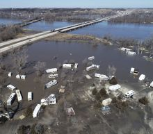 The Latest: Minnesota to help Nebraska flood fight