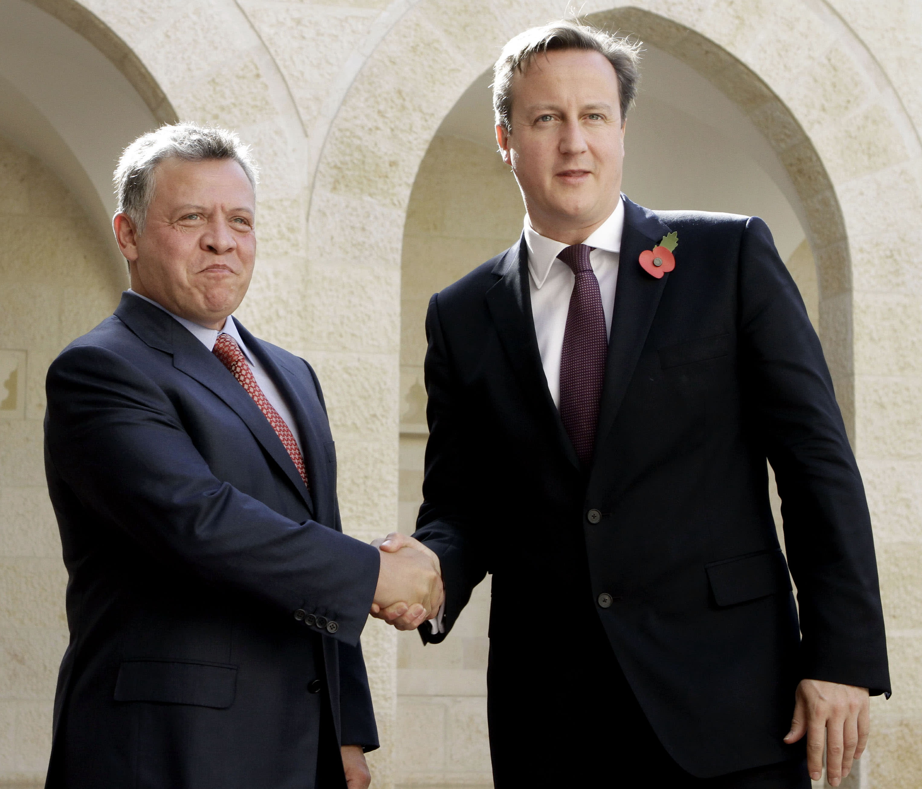 King Abdullah II of Jordan ,left, shake hands with British Prime Minister David Cameron at the Royal Palace in Amman, Jordan, Wednesday, Nov. 7 2012. Cameron is in the Kingdom on a short visit, as part of a regional tour. (AP Photo/Raad Adayleh)