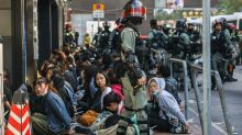 Hong Kong Police Storm University Campus Occupied by Protesters as Courts Overturn Mask Ban