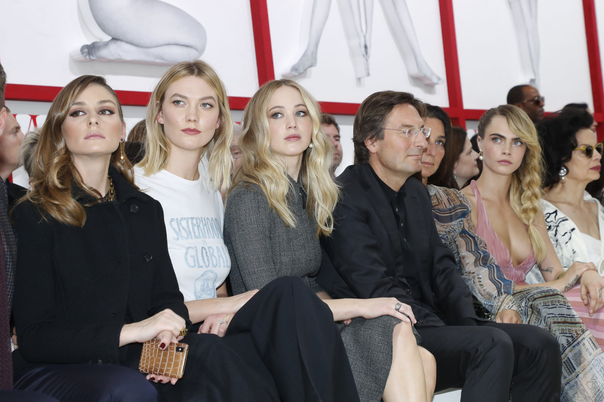 PARIS, FRANCE - FEBRUARY 26: (L-R) Olivia Palermo, Karlie Kloss, Jennifer Lawrence, CEO of Dior Pietro Beccari, his wife Elisabetta Beccari, Cara Delevingne and Bianca Jagger attend the Christian Dior show as part of the Paris Fashion Week Womenswear Fall/Winter 2019/2020 on February 26, 2019 in Paris, France. (Photo by Bertrand Rindoff Petroff/Getty Images)