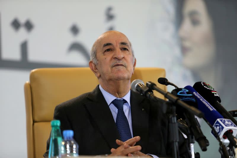 FILE PHOTO: Newly elected president Abdelmadjid Tebboune talks to the press during a news conference, in Algiers,