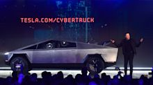 UPDATE 4-Tesla's electric pickup breaks the mould with angular design and armored glass