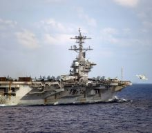US Navy captain says carrier faces dire coronavirus threat