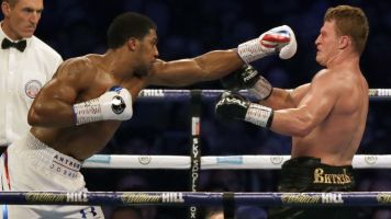 Joshua stops Povetkin in 7th round, keeps title