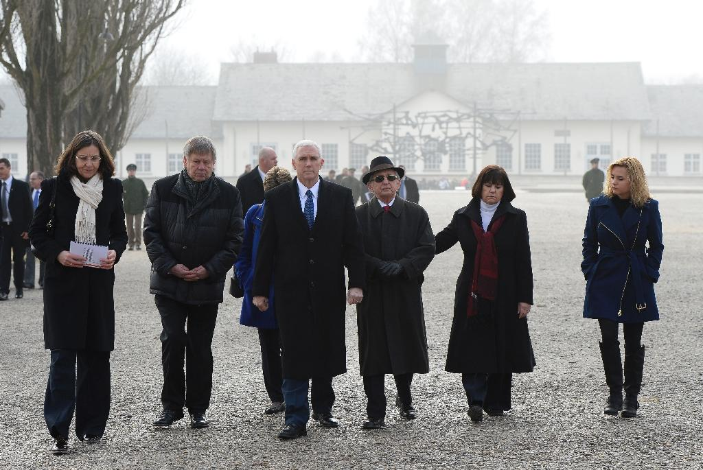 US Vice President Mike Pence (3rdL) and his family are joined by ex-Dachau prisoners as they visit the Dachau concentration camp in southwestern Germany, on February 19, 2017 (AFP Photo/Thomas Kienzle )