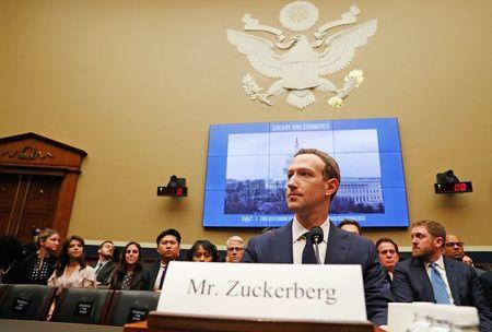 Facebook's Zuckerberg unscathed by congressional grilling, stock rises