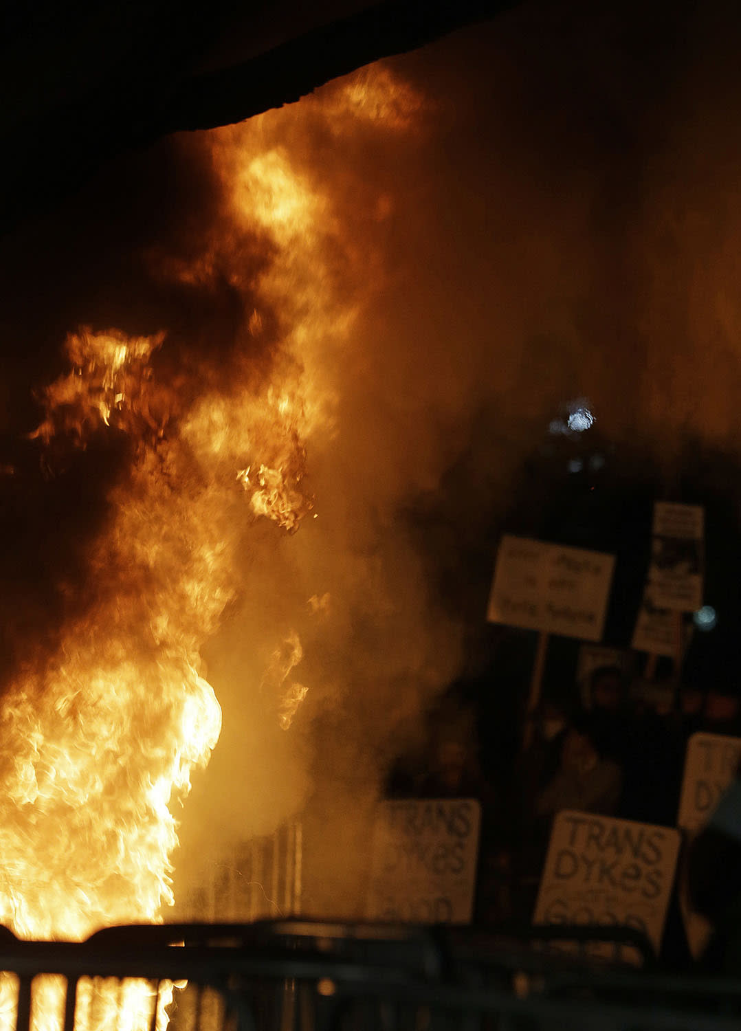 <p>Protesters watch a bonfire on Sproul Plaza during a rally against the scheduled speaking appearance by Breitbart News editor Milo Yiannopoulos on the University of California at Berkeley campus on Feb. 2, 2017, in Berkeley, Calif. (Photo: Ben Margot/AP) </p>