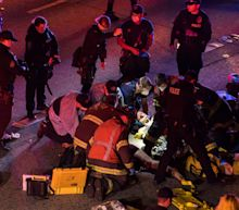 Protester killed and another fighting for life after car hits Seattle march