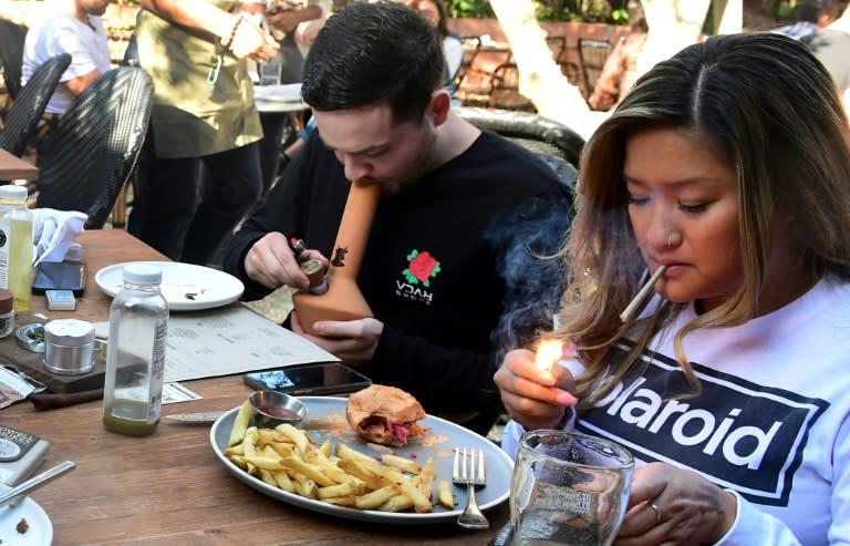 People smoke marijuana in West Hollywood, California in 2009
