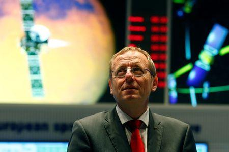 Jan Woerner, Director General of the European Space Agency (ESA) looks up prior to an exclusive Reuters interview in the main control room of the European Space Operations Centre (ESOC) in Darmstadt, Germany June 17, 2016. REUTERS/Ralph Orlowski