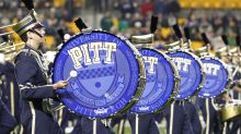 Pittsburgh kicker Ian Troost kneels during national anthem