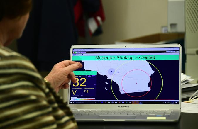 Margaret Vinci, manager of the Seismological Laboratory at California Institute of Technology (Caltech) points to a shake alert user display on a laptop screen, set for a limited release on June 1, 2017 at the Caltech Seismological Laboratory in Pasadena, California, where they addressed the elimination of federal funding for the West Coast Earthquake early Warning system, also known as ShakeAlert, in President Trump's FY2018 budget. / AFP PHOTO / FREDERIC J. BROWN        (Photo credit should read FREDERIC J. BROWN/AFP via Getty Images)