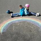 Here's why rainbows are popping up at homes across the country