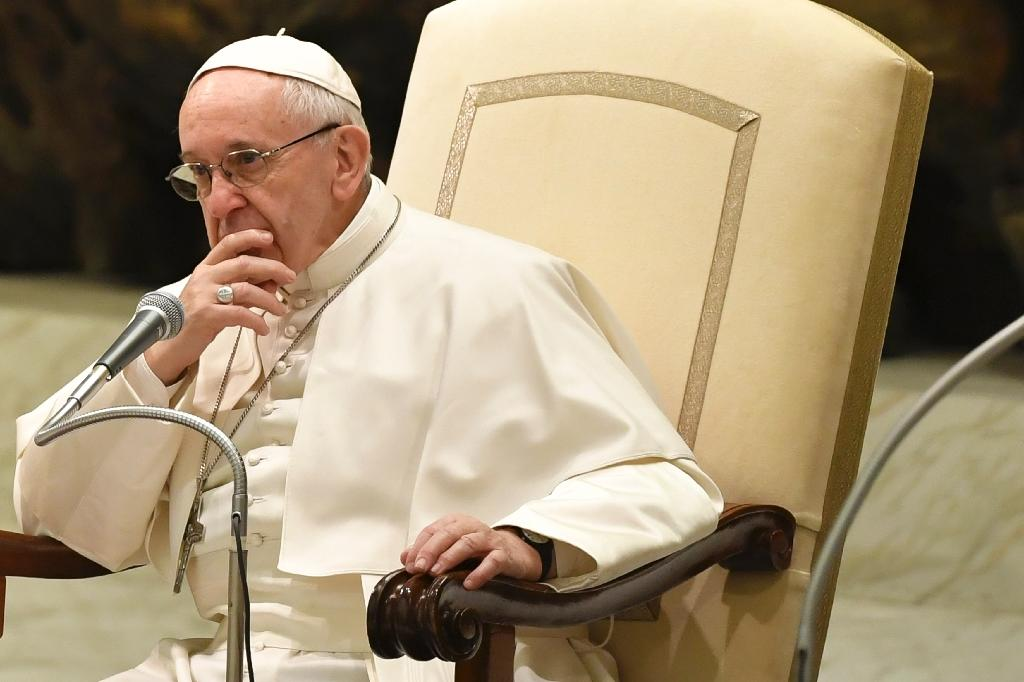 Pope Francis looks on during a general audience at the Paul VI Audience Hall at the Vatican on February 8, 2017