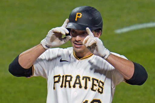 Pittsburgh Pirates' Bryan Reynolds crosses home plate after hitting a two-run home run off St. Louis Cardinals starting pitcher Daniel Ponce de Leon during the fifth inning of the second baseball game of a doubleheader in Pittsburgh, Friday, Sept. 18, 2020. (AP Photo/Gene J. Puskar)