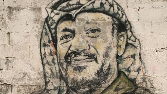 Arafat's remains exhumed as poison probe begins
