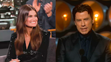 Idina Menzel says John Travolta owes her a favor, and she's ready to cash it in