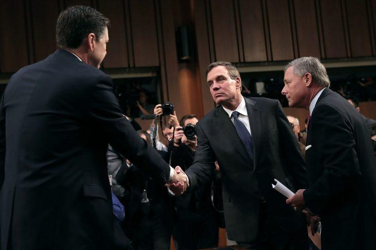 Former FBI Director James Comey (L) is greeted by Senate Intelligence Committee Chairman Richard Burr (R-NC) (R) and ranking member Sen. Mark Warner (D-VA) before a hearing in the Hart Senate Office Building on Capitol Hill June 8, 2017 in Washington. (Photo: Drew Angerer/Getty Images)